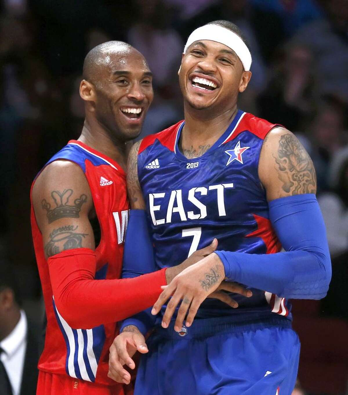 NBA All-Star Kobe Bryant of the Los Angeles Lakers (L) and All-Star Carmelo Anthony of the New York Knicks laugh during the NBA All-Star basketball game in Houston, Texas, February 17, 2013. REUTERS/Lucy Nicholson (UNITED STATES - Tags: SPORT BASKETBALL)