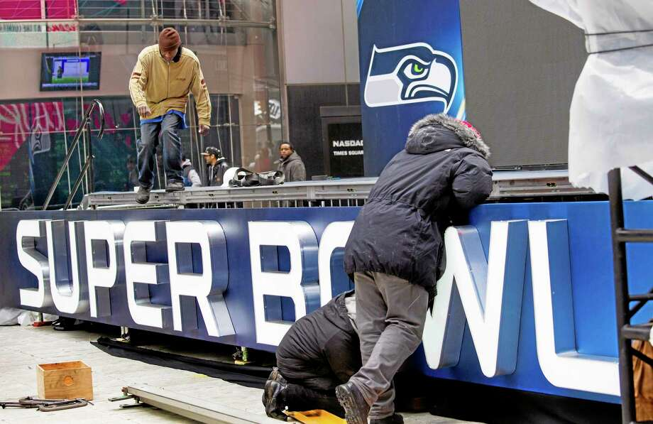 A stage structure, part of Super Bowl activities on New York's Times Square, comes together Monday. Up to 13 blocks of Broadway in the heart of Manhattan will close to traffic for four days so the NFL can host a Super Bowl festival called Super Bowl Boulevard according to the NFL. Photo: Craig Ruttle — The Associated Press  / FR61802 AP