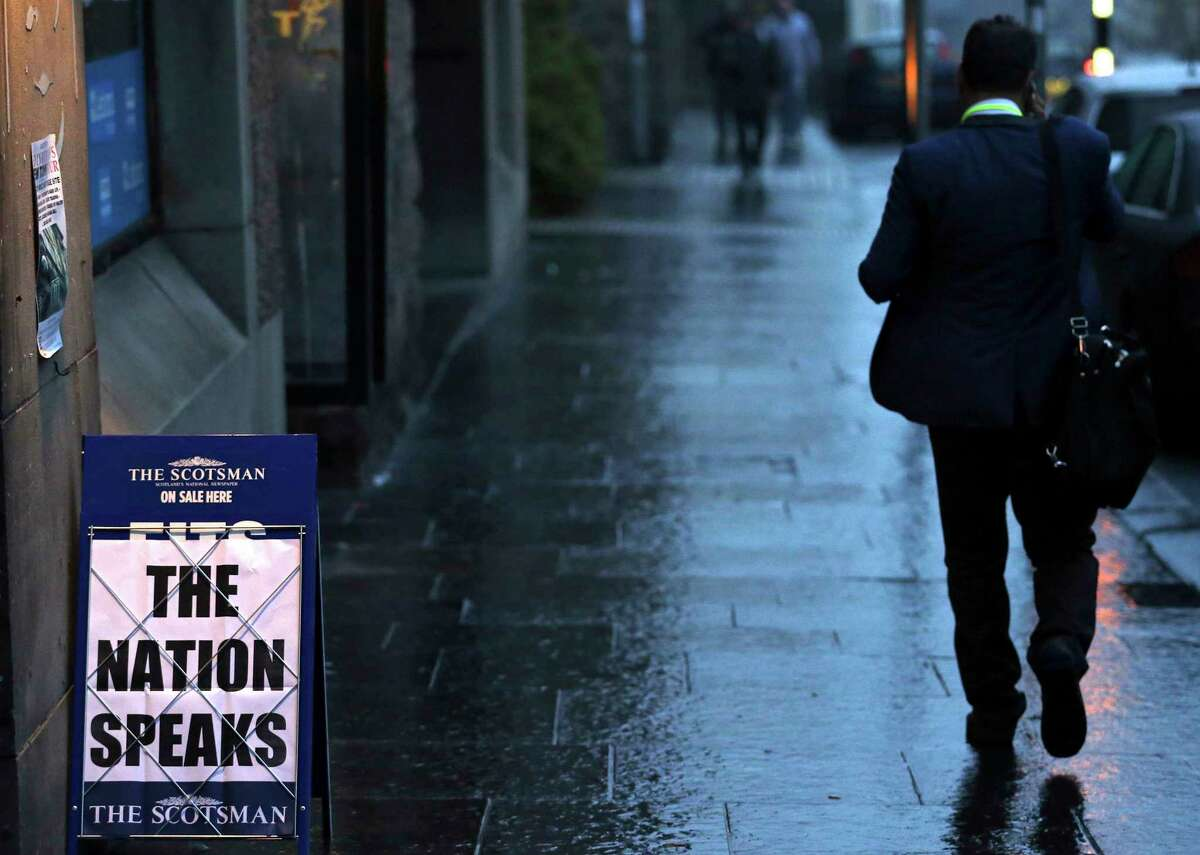 A newspaper advertising board displays a message for the Scottish independence referendum at a newsagents Friday on the Royal Mile in Edinburgh, Scotland.