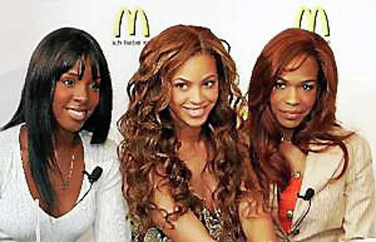 Kelly Rowland, left, Beyonce Knowles, center, and Michelle Williams, are shown in Hamburg, Germany, in this May 19, 2005, file photo.