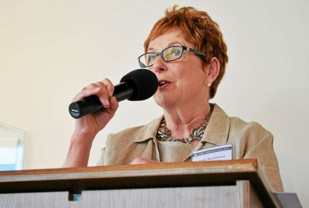 Judy McElhone, executive director of the Five Points Gallery, talks about plans to expand the artist space during a press conference Thursday, June 28. (Tom Caprood-Register Citizen)