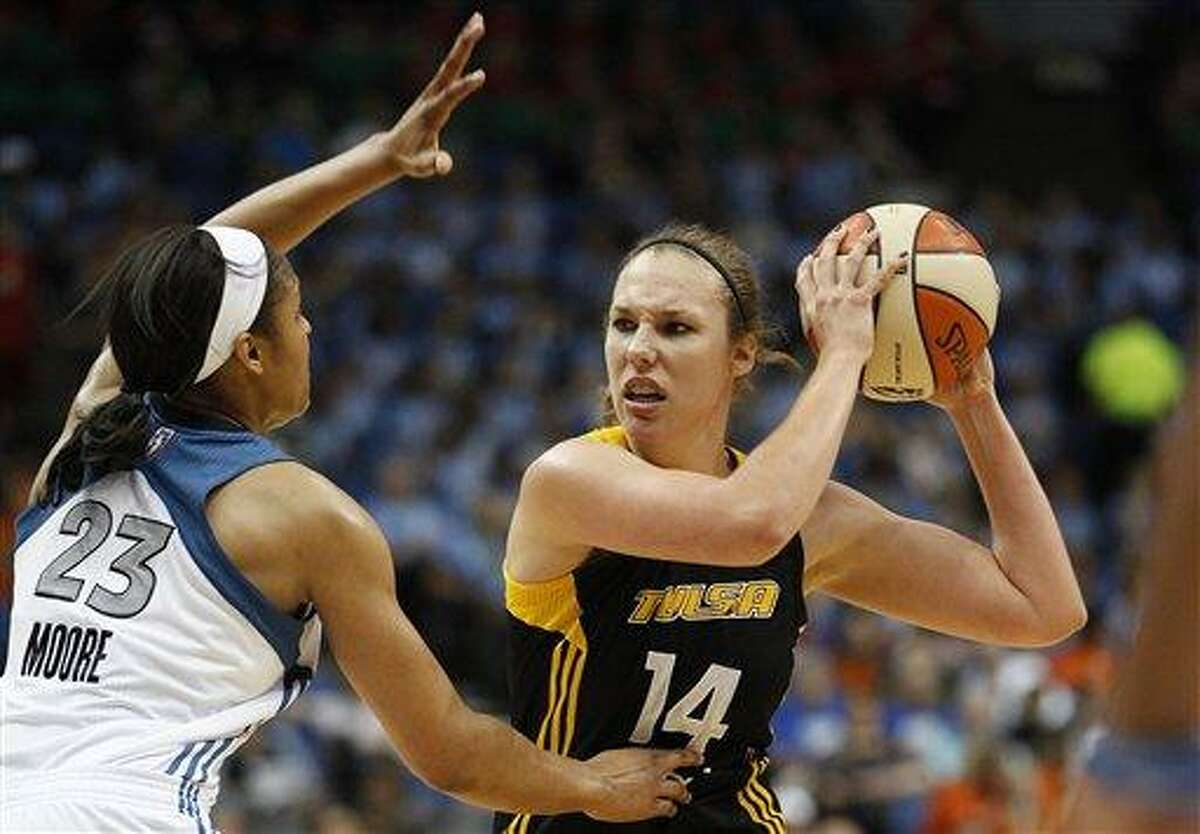Tulsa Shock forward Kayla Pedersen (14) looks to make a pass against Minnesota Lynx forward Maya Moore (23) during the first half of a WNBA basketball game, Thursday, July 12, 2012, in Minneapolis. (AP Photo/Stacy Bengs)