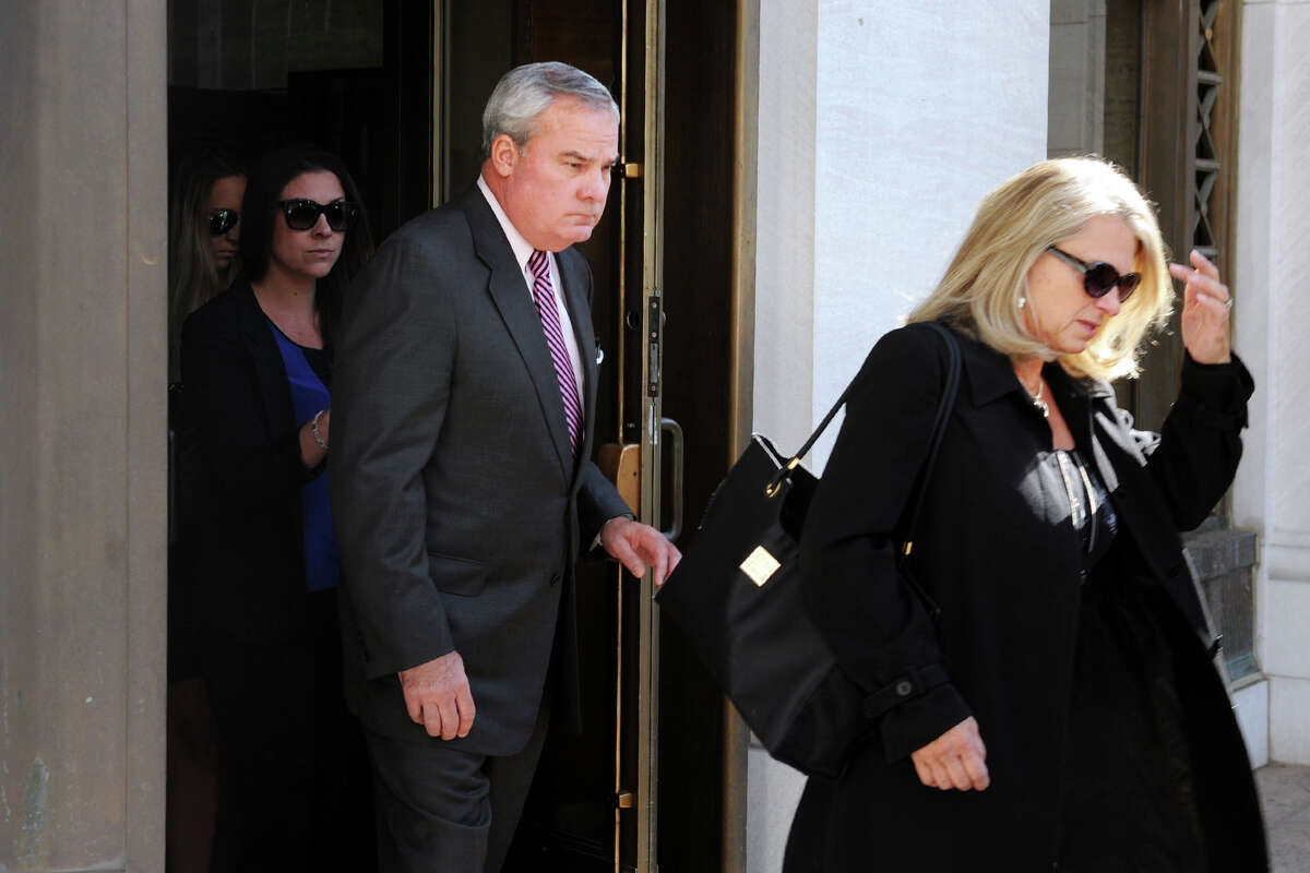 Former Gov. John G. Rowland and his wife Patty, right, leave the Federal Courthouse in New Haven Friday.