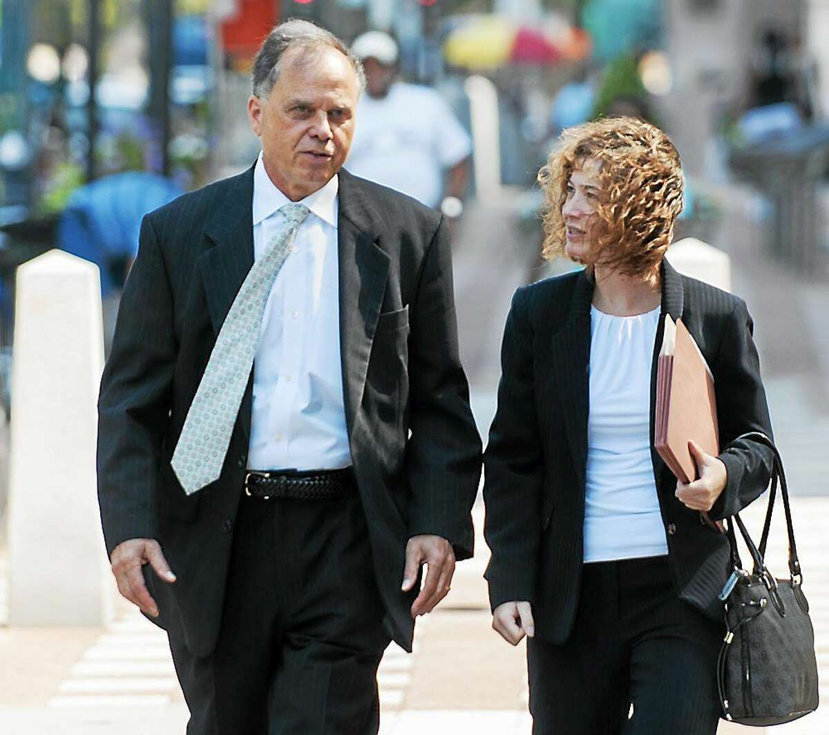 Brian Foley enters the Federal Court House in New Haven Friday as a government witness to former Conn. Gov. John G. Rowland alleged campaign financing fraud. With him is Jessica Santos, his attorney.