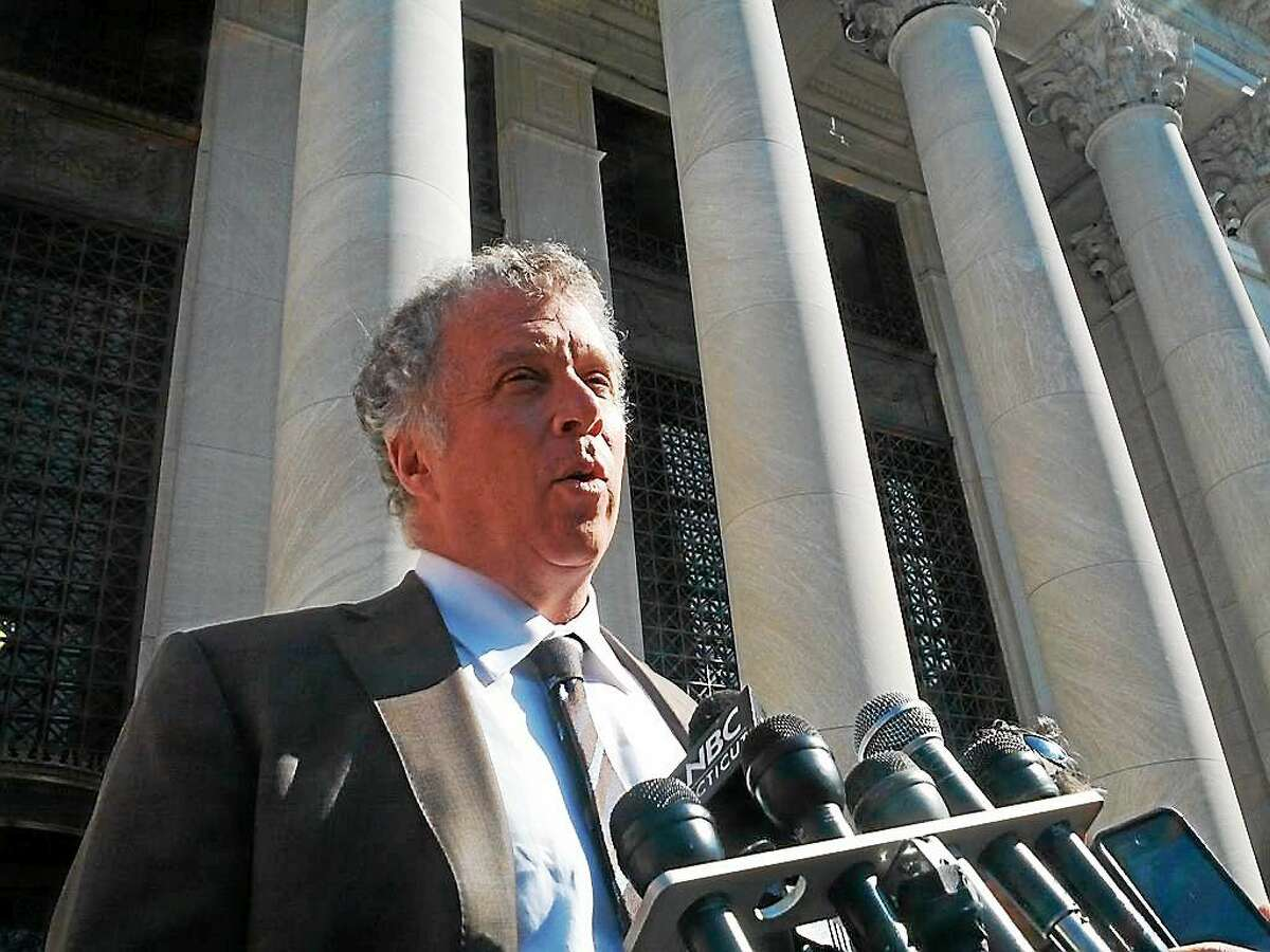 Rowland's attorney, Reid Weingarten, speaks outside federal court in New Haven following the verdict Friday.