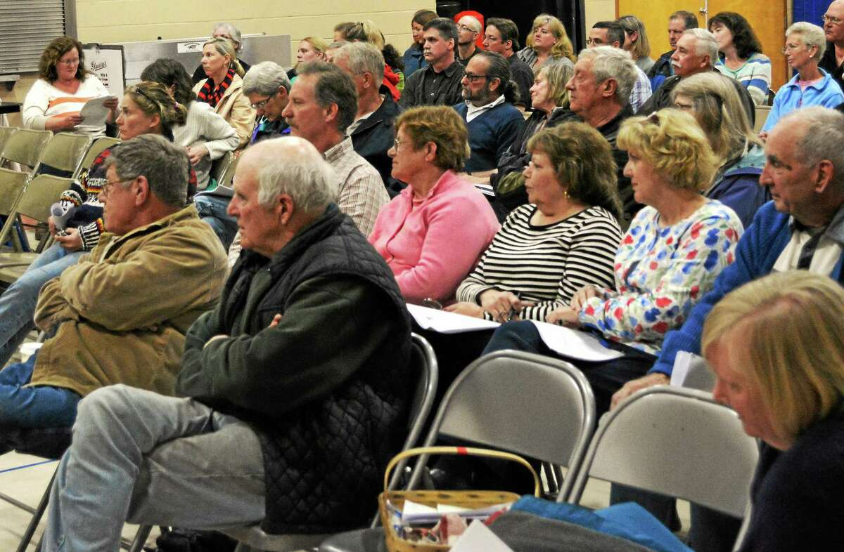 Colebrook residents listen during a presentation by the Regionalization Study Committee during an informational meeting Thursday. A proposed plan would close Colebrook Consolidated School and move its student population to Norfolkís Botelle School.