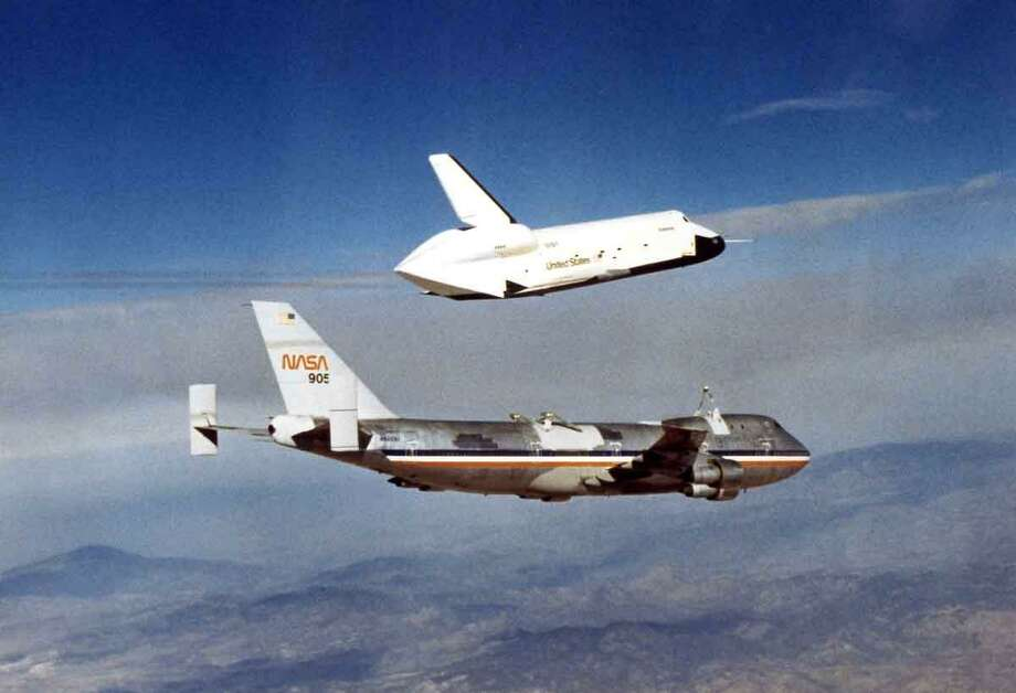 """The Space Shuttle Enterprise test vehicle on its maiden """"flight"""" on top of a Boeing 747."""