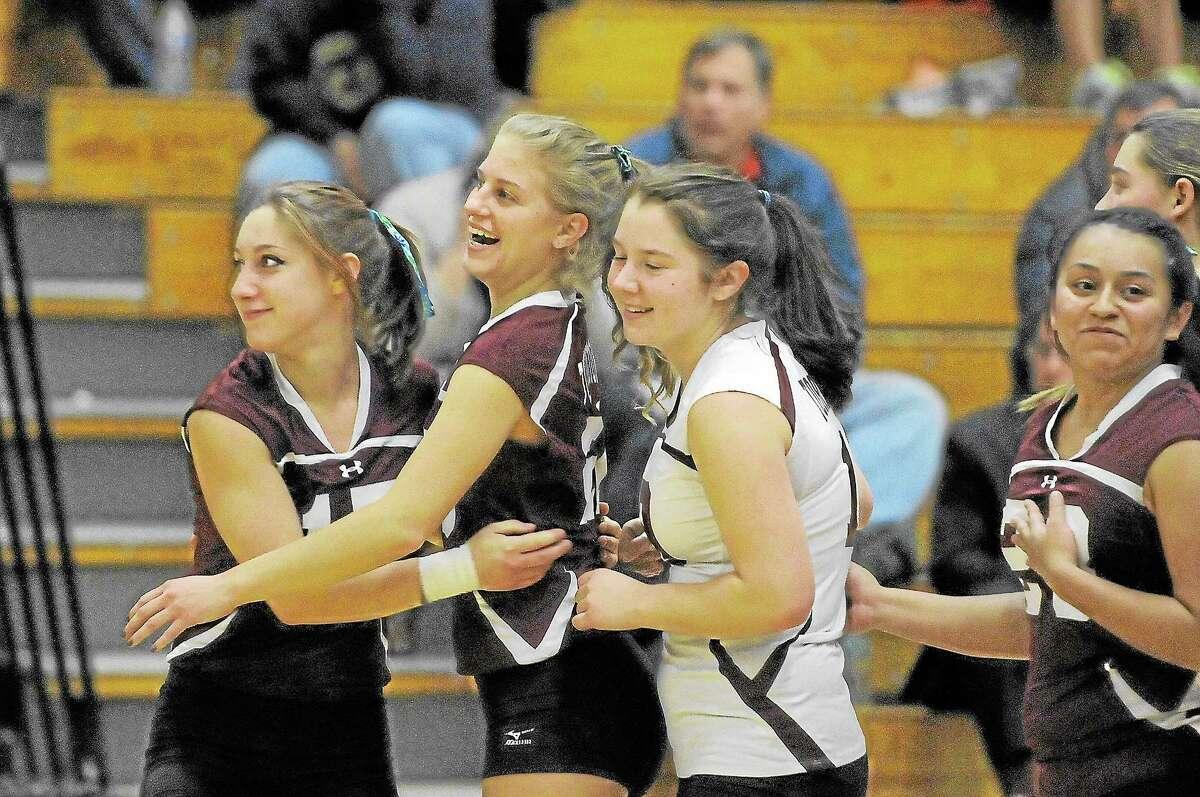 Torrington's Kiley Rosengrant (left), Jenna Gyuricsko (center left), Shelby (center right) and Rosa Hernandez (right) celebrate after defeating Naugatuck 3-2 and advancing to the NVL finals.