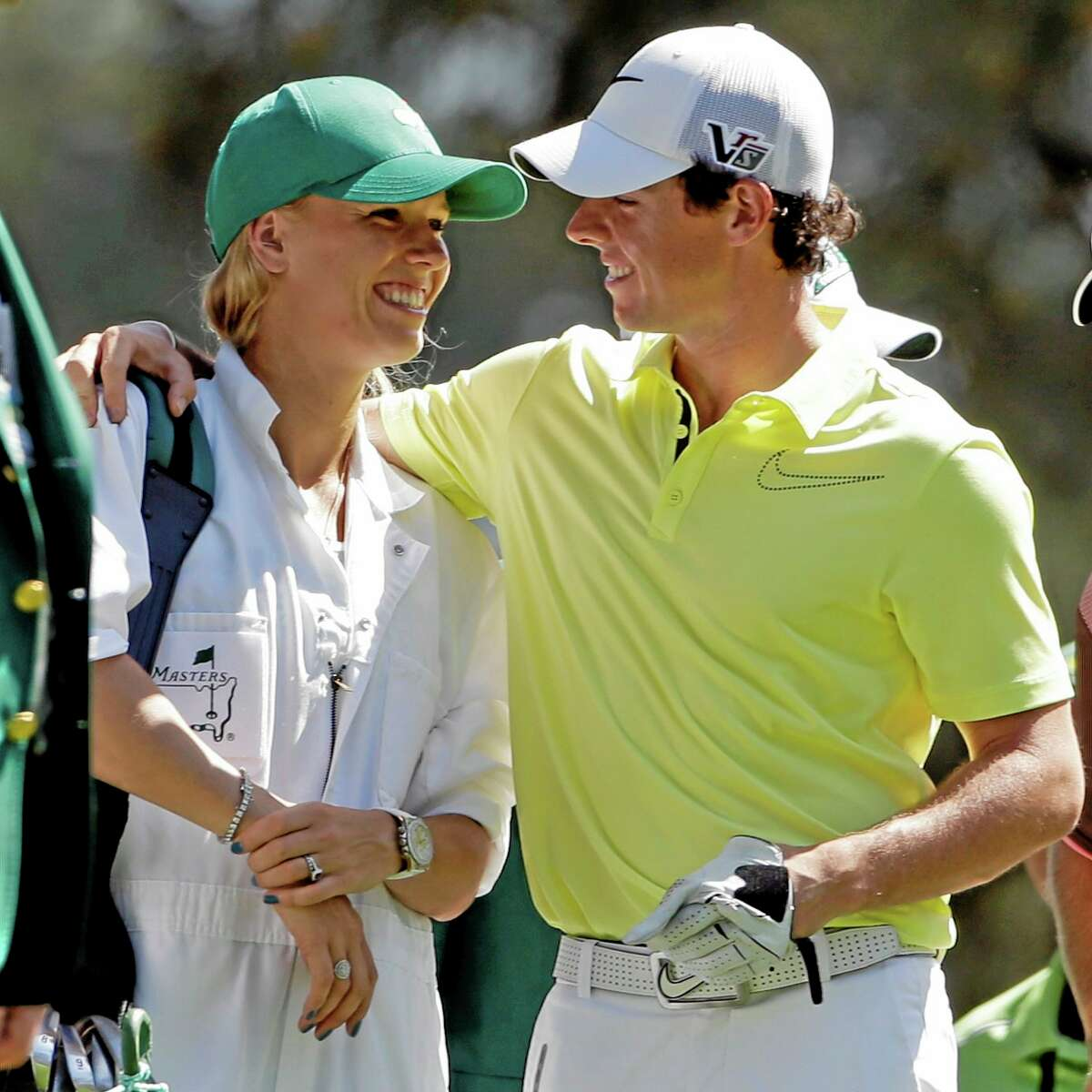 In this April 10, 2013 file photo, Rory McIlroy hugs his caddie, four-time New Haven Open champion Caroline Wozniacki, during the par three competition before the Masters in Augusta, Ga. McIlroy has broken off his engagement to Wozniacki only days after sending out wedding invitations.