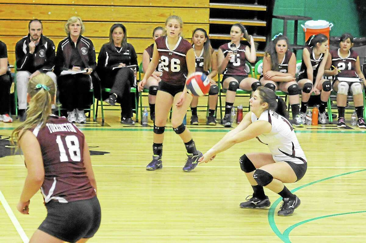 Torrington's Shelby Consolini makes a pass during the Red Raiders 3-2 win over Naugatuck in the NVL semifinals. Consolini had 47 digs in the win.