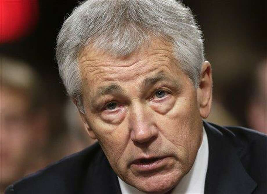 Republican Chuck Hagel, President Obama's choice for defense secretary, testifies before the Senate Armed Services Committee during his confirmation hearing, on Capitol Hill in Washington, Thursday, Jan. 31, 2013. (AP Photo/J. Scott Applewhite) Photo: AP / AP