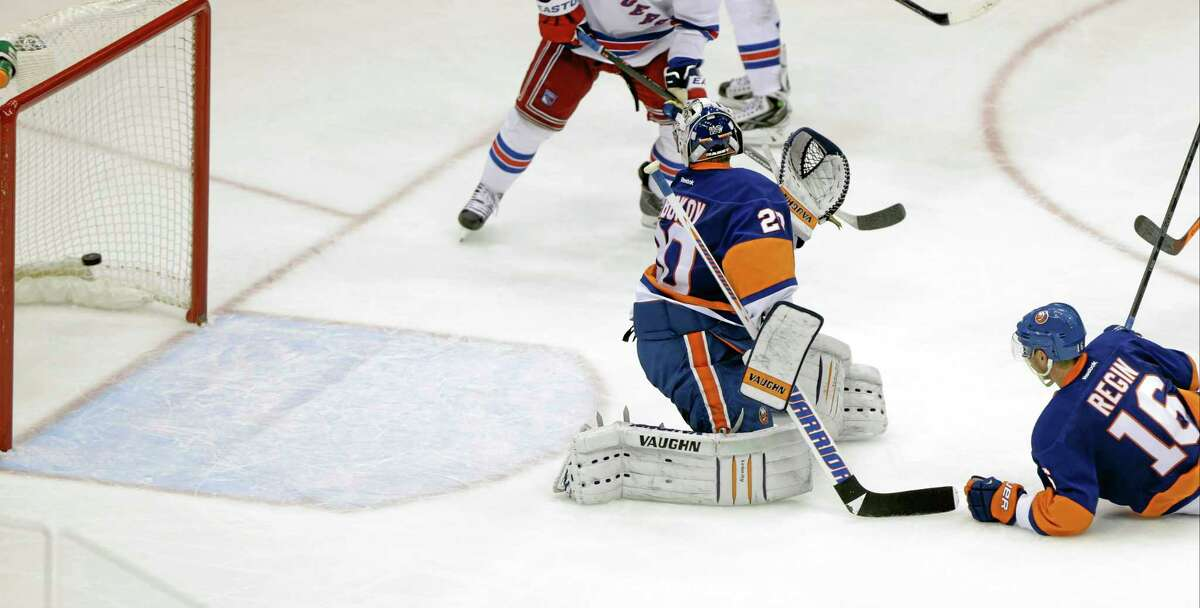 New York Islanders goalie Evgeni Nabokov watches a puck shot by the New York Rangers' Benoit Pouliot gets past him for a goal during the third period Tuesday in Uniondale, N.Y. The Rangers won the game 3-2.