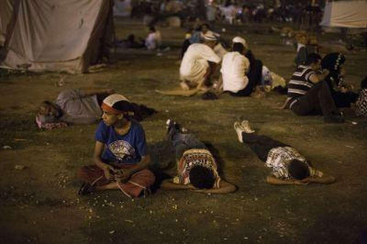 Egyptian children rest in Tahrir Square during a demonstration against President Mohammed Morsi in Cairo, Thursday, June 27, 2013.
