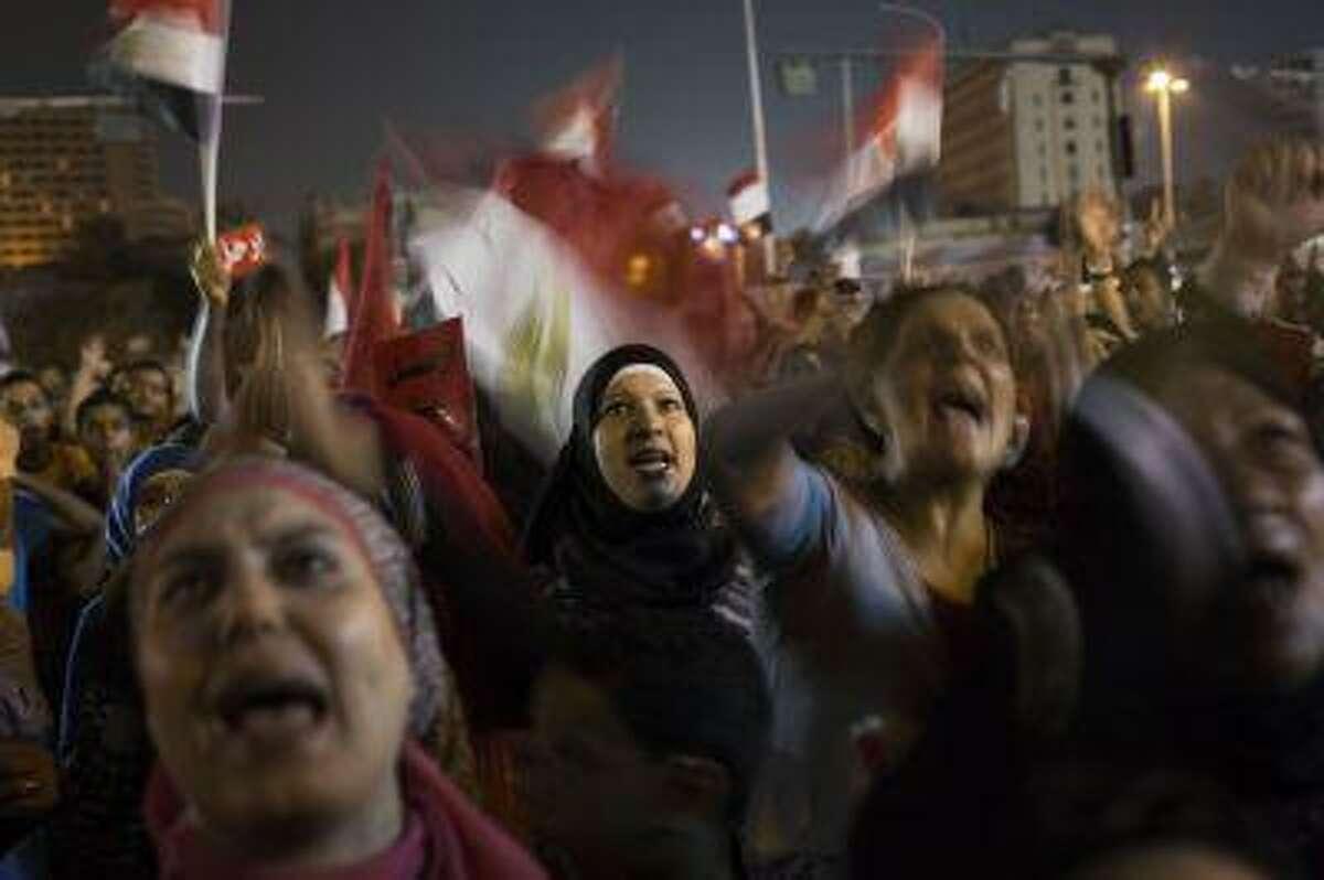 Egyptian women chant slogans against President Mohammed Morsi during a demonstration in in Tahrir Square in Cairo, Thursday, June 27, 2013.