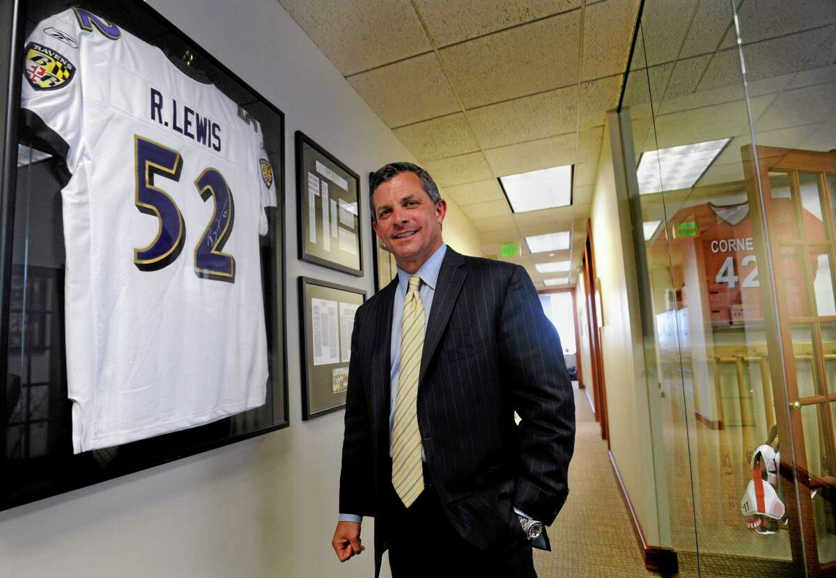 Attorney Steve Silverman stands in a hallway outside his office Tuesday in Baltimore. A group of retired players accused the NFL in a lawsuit Tuesday of cynically supplying them with powerful painkillers and other drugs that kept them in the game but led to serious complications later in life. The lawsuit, which seeks unspecified damages on behalf of more than 500 ex-athletes, charges the NFL with putting profits ahead of players' health. Silverman is an attorney for the players.