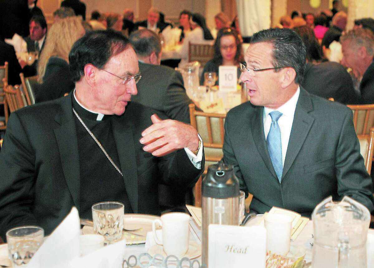 Reverend Henry J. Mansell, Archbishop of Hartford, left, with Governor Dannel P. Malloy during the Archbishop's Columbus Day Breakfast at Anthony's Ocean View in New Haven, Conn. Friday morning October 11, 2013. The breakfast is a fundraising benefit to provide scholarship grants to students attending the Catholic elementary schools of the greater New Haven area, sponsored by the Foundation for the Advancement of Catholic Schools.