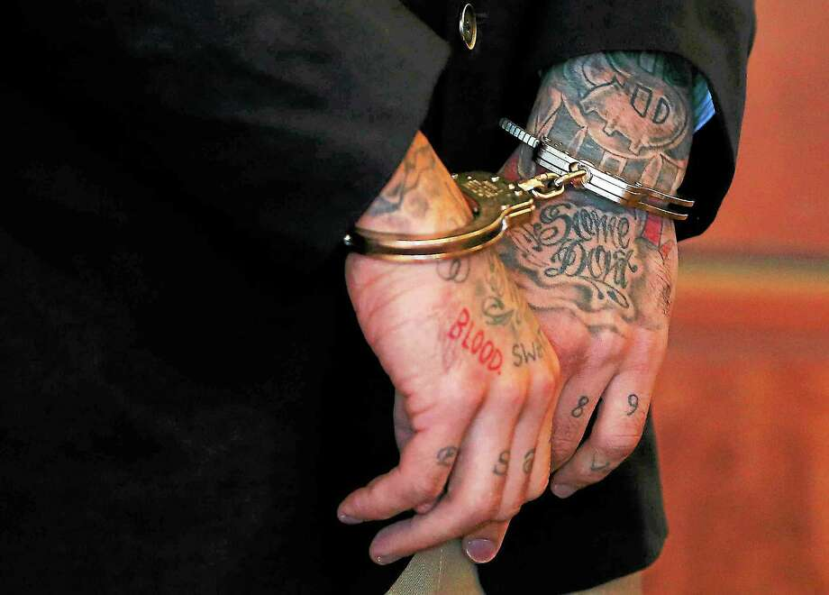 Former New England Patriots tight end Aaron Hernandez is handcuffed during a pretrial court hearing in Fall River, Massachusetts, on Oct. 9, 2013. Photo: Brian Snyder — The Associated Press  / AP2013