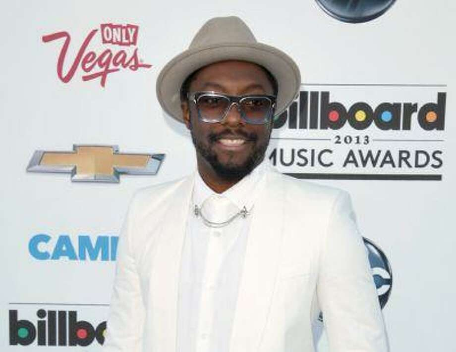 "In this May 19, 2013 photo, <a href=""http://Will.i.am"">Will.i.am</a> arrives at the Billboard Music Awards at the MGM Grand Garden Arena in Las Vegas. <a href=""http://Will.i.am"">Will.i.am</a> says his ""I AM"" trademark is too similar to one Pharrell's company tried to register. (Photo by John Shearer/Invision/AP, File) Photo: John Shearer/Invision/AP / A2013"