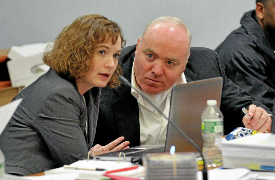 FILE - In a Friday, April 26, 2013 file photo, Michael Skakel, right, talks to Jessica Santos, one of his defense attorneys, during his appeal at State Superior Court in Vernon, Conn. On Wednesday, Oct. 23, 2013, Skakel's conviction in the death of Moxley was set aside and new trial ordered by a Connecticut judge, Thomas Bishop, who ruled that Sherman failed to adequately represent him when he was found guilty in 2002. Skakel's current attorney, Hubert Santos, said he expects to file a motion for bail on Thursday. If a judge approves it, Skakel could then post bond and be released from prison. (AP Photo/The Stamford Advocate, Jason Rearick, Pool, File) Photo: AP / Pool; The Stamford Advocate