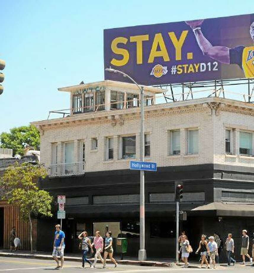A billboard above Hollywood Boulevard in Los Angeles asks Dwight Howard to stay with the Lakers.