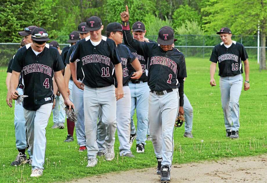 Torringtonís Stanly Rijo holds up the number one as the Red Raiders walk off the field after beating Wilby, 10-3, to win the Copper Division Title for the second time in three years. Photo: Pete Paguaga — Register Citizen