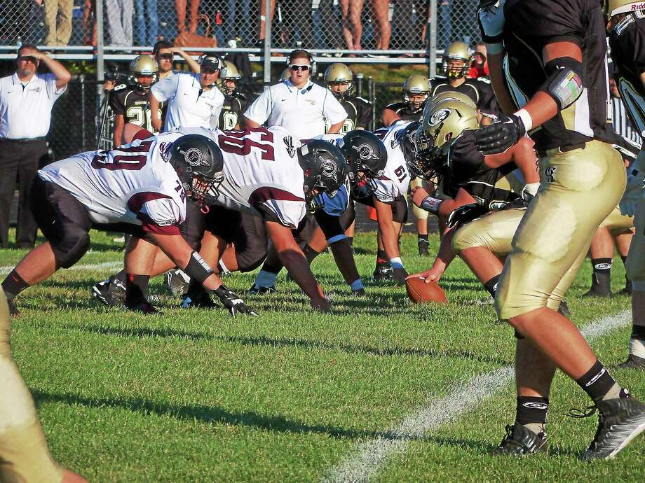 Torrington's defensive line stopped Woodland on the one-yard line for a 28-27 win in overtime at Woodland. Photo: Peter Wallace — Register Citizen