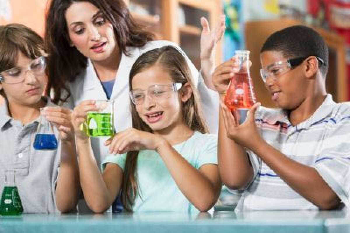 Teacher and students in science lab.