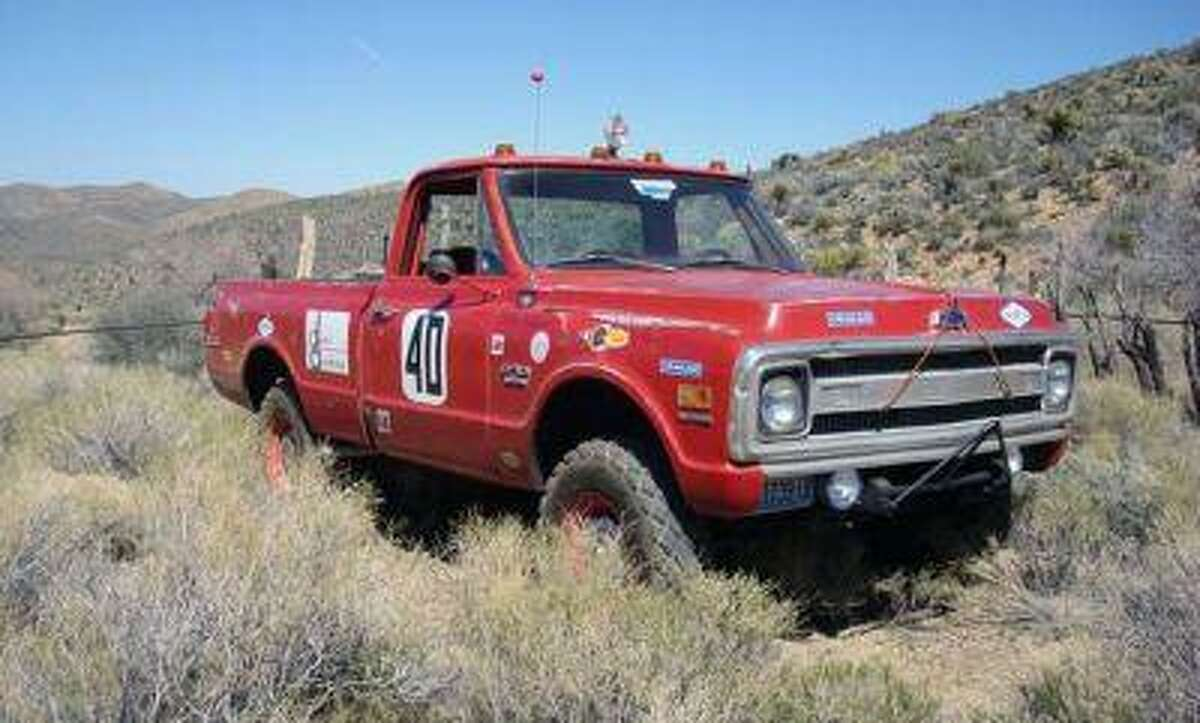 This photo provided by Courtesy of Mecum Auctions, a 1969 Chevrolet C/10 Baja race truck once owned by actor Steve McQueen is shown. McQueen's old truck and prescription sunglasses worn by John Lennon are among hundreds of items once owned by celebrities that are scheduled to be auctioned in California next month. The Mecum Auction Company said Wednesday, June 26, 2013, it will be displaying and auctioning about 2,000 pieces of celebrity-related memorabilia in Santa Monica, Calif. on July 26-27. Mecum, which specializes in the sale of collector cars, says one of the auction's highlights will be Elvis' 1972 Cadillac Custom Estate Wagon.