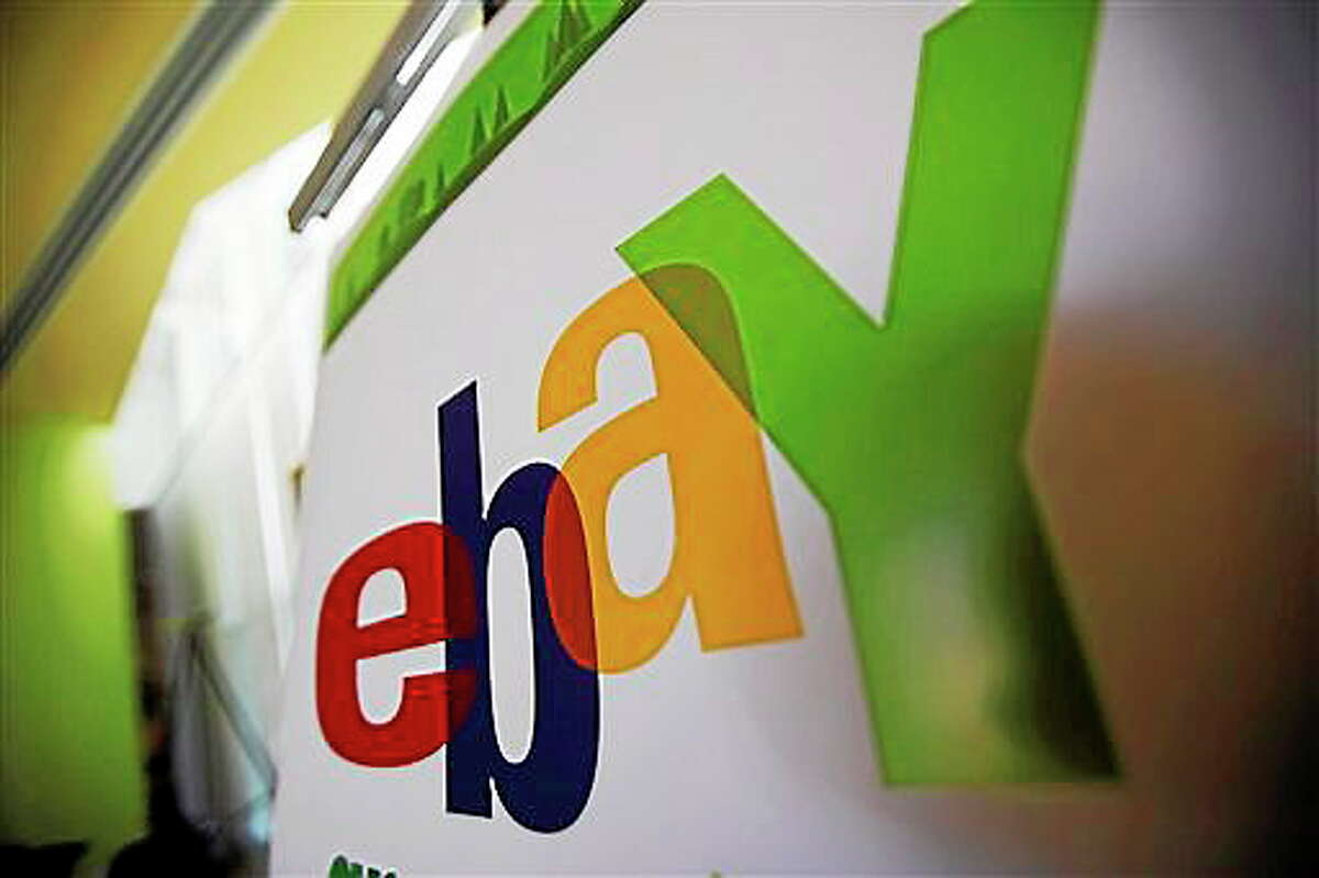 In this Feb. 24, 2010 file photo, an eBay logo is seen at their offices in San Jose, Calif.
