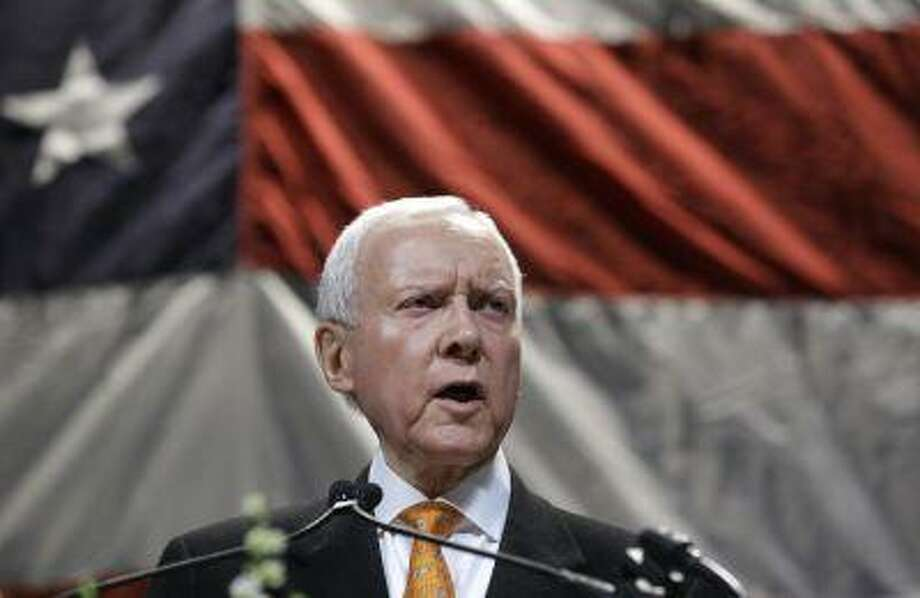 FILE - In a May 18, 2013, file photo, Republican Sen. Orrin Hatch addresses the Utah Republican Party's annual organizing convention, in Sandy, Utah. Hatch says he'll vote in favor of the latest immigration reform package, retreating from his demand that the Senate bill require immigrants here illegally to pay back taxes. (AP Photo/Rick Bowmer, File) Photo: AP / AP