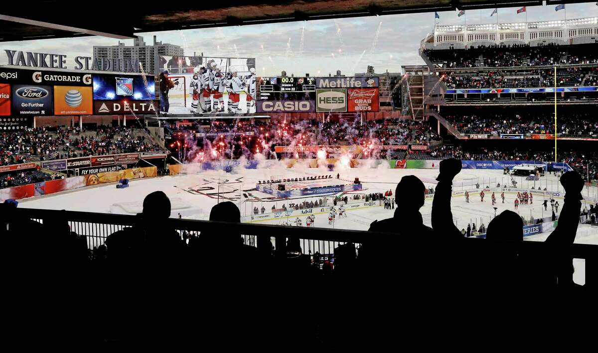 Rangers fans cheer during a pyrotechnics display after Saturday's game against the Devils at Yankee Stadium. The Rangers won 7-3.