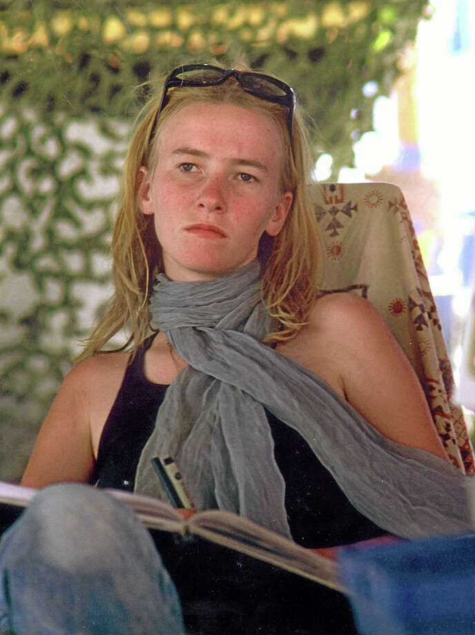 FILE - This Sept. 2002 file photo show activist Rachel Corrie is shown at the Burning Man festival in Black Rock City, Nev. The family of the slain American activist on Wednesday, May 21, 2014 appealed to the Israeli Supreme Court to overturn a lower court's ruling and hold the military accountable for their daughter's death. Corrie was crushed to death over a decade ago by an Israeli military bulldozer razing Palestinian homes in an area the army said militants used for cover, in the southern town of Rafah near the Gaza border with Egypt.(AP Photo/Denny Sternstein, File) Photo: AP / AP