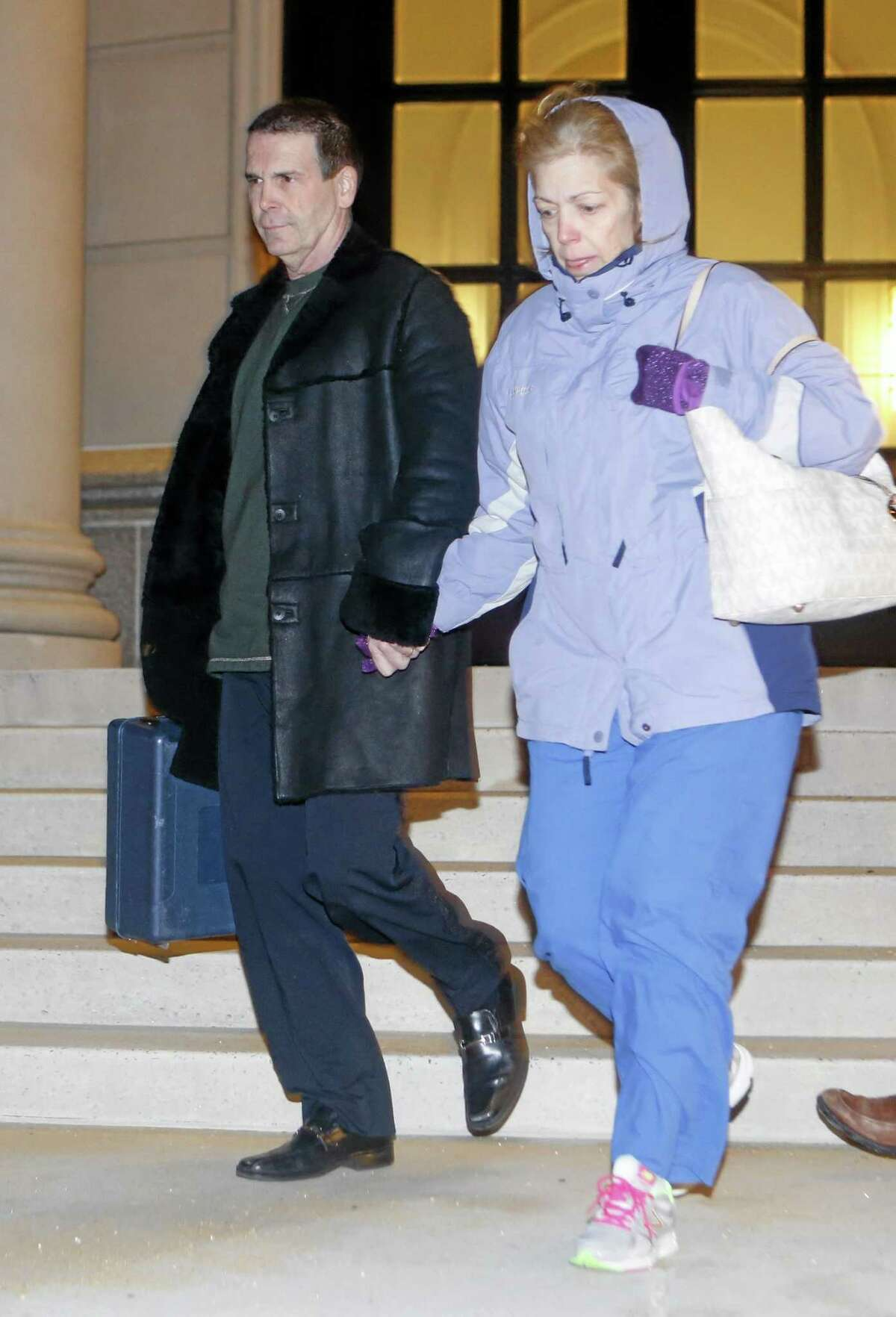 In this Jan. 23, 2014 photo, Mount Pleasant, N.Y. police Chief Brian Fanelli and his wife Sonja exit Federal Court in White Plains, N.Y. A five-week investigation has resulted in charges against at least 70 men and one woman in the New York City area in what officials called one of the largest-ever roundups locally of people who anonymously trade child porn over the Internet. Authorities decided to launch the operation after the arrest of Fanelli, who pleaded not guilty this week to federal charges of knowingly receiving and distributing child pornography. (AP Photo/The Journal News, Tania Savayan) NYC OUT, NO SALES