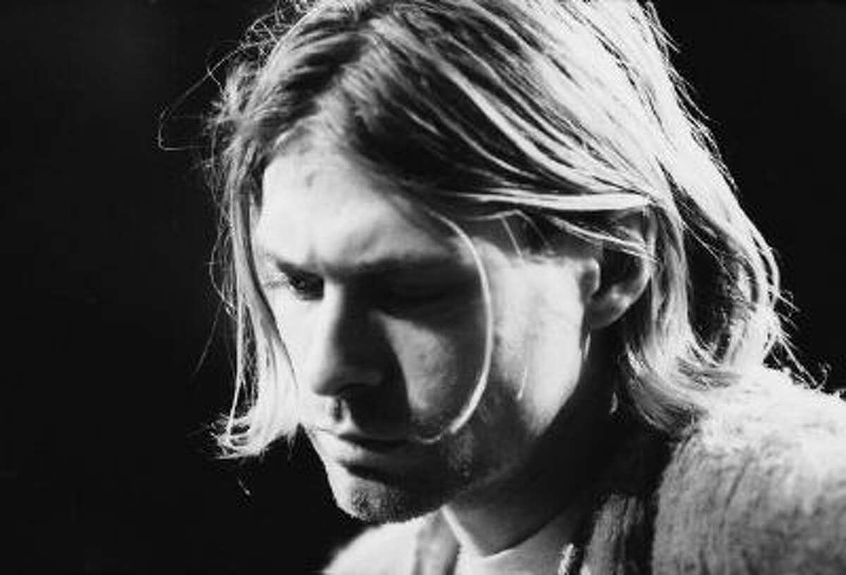 Kurt Cobain (1967 - 1994), performs with his group Nirvana at a taping of