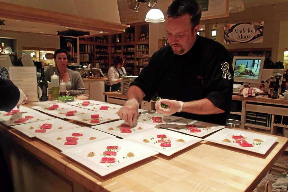 Chef Plum Luv at work at the recent pop-up dinner at the Williams-Sonoma in the Danbury Fair Mall. Photo: Journal Register Co.