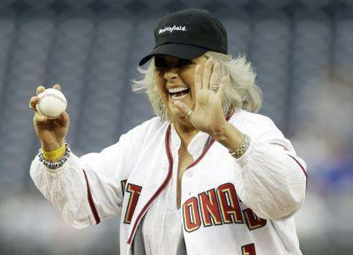 Food Network personality Paula Deen laughs before throwing out the first pitch prior to the Washington Nationals versus New York Mets MLB baseball game in Washington in this file photo taken May 19, 2010. REUTERS/Gary Cameron/Files