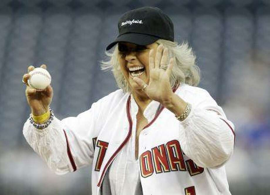Food Network personality Paula Deen laughs before throwing out the first pitch prior to the Washington Nationals versus New York Mets MLB baseball game in Washington in this file photo taken May 19, 2010. REUTERS/Gary Cameron/Files Photo: REUTERS / X00044