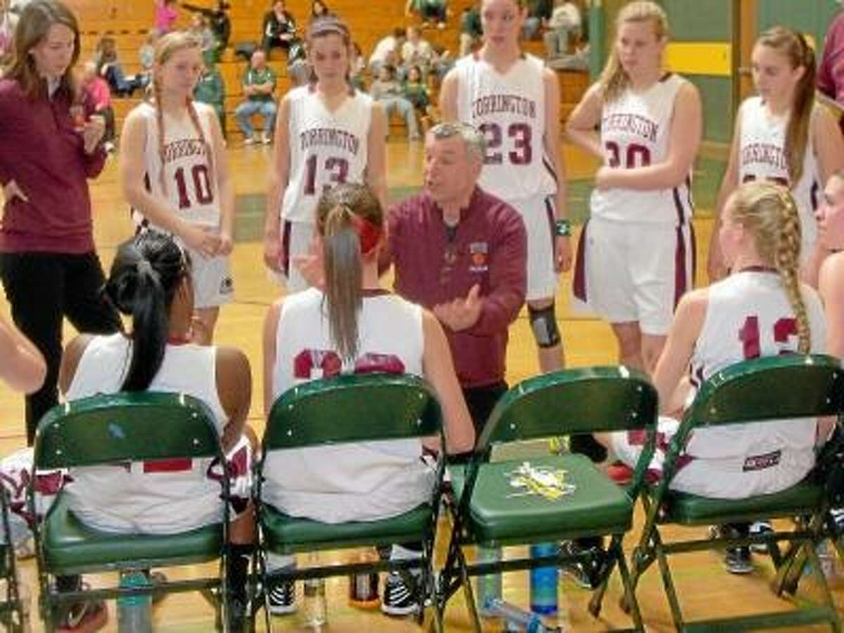 Torrington High School girls basketball coach Mike Fritch lays out the plan in Torrington's 61-39 NVL Quarterfinal win over Woodland Monday afternoon.