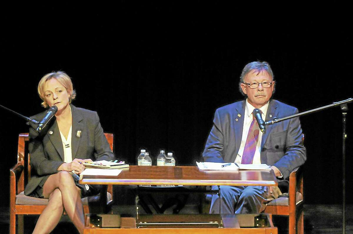 Laurie Gaboardi-Register Citizen ¬ Torrington mayoral candidates Elinor Carbone, a Republican, and Democrat George Craig participated in a debate at the Warner Theatre on Thursday, Oct. 24.