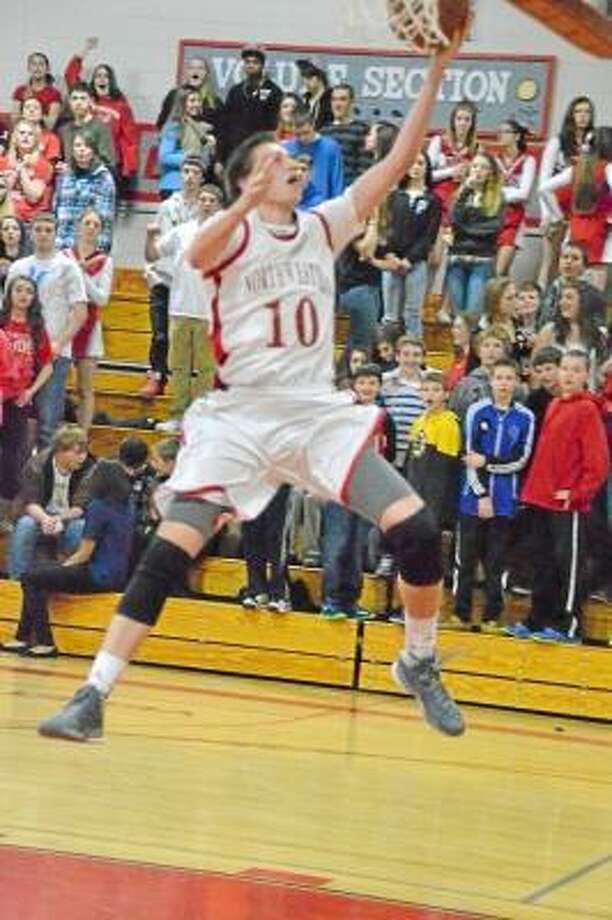 Northwestern's John Stevens scores two of his game high 21 points. The Highlanders defeated Terryville 71-64.