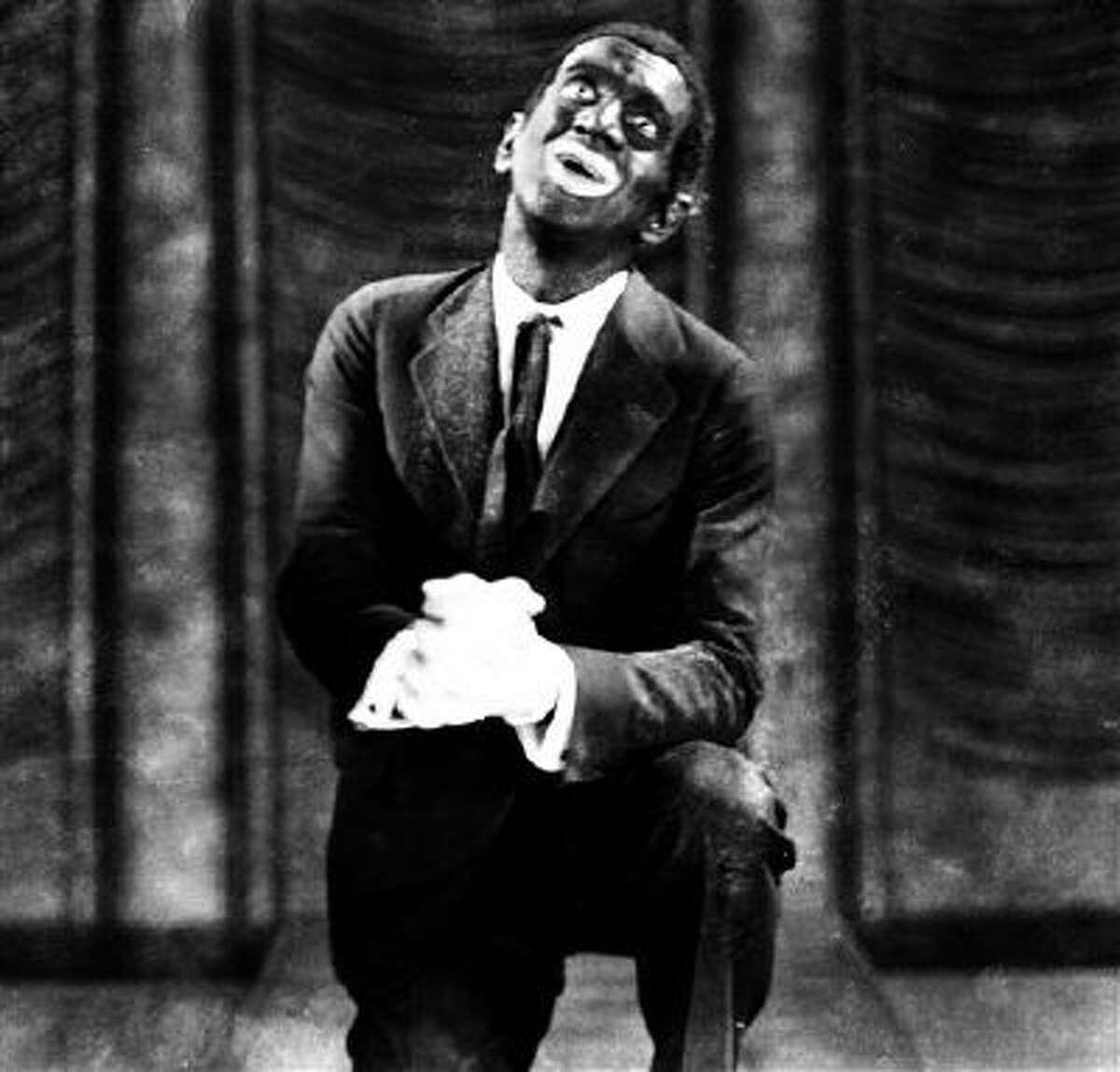 This 1927 image originally released by Warner Bros., shows Al Jolson in blackface makeup in the movie