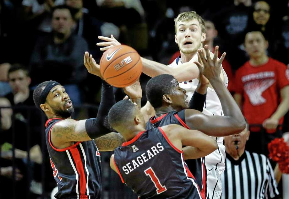 UConn guard Niels Giffey is swarmed by Rutgers defenders during the second half of Saturday's game against Rutgers. Photo: Mel Evans — The Associated Press  / AP