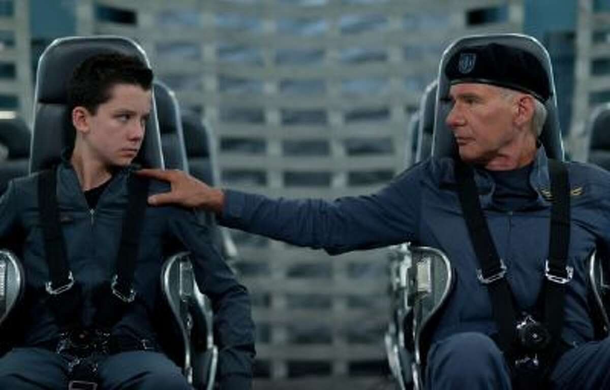 Asa Butterfield, left, and Harrison Ford in a scene from