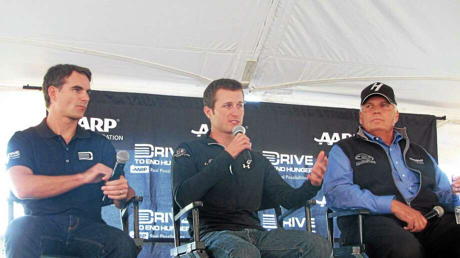 NASCAR's Jeff Gordon, Kasey Kahne, and Hendrick Motorsports owner Rick Hendrick speak at Lime Rock Park Thursday as part of the park's Drive to End Hunger Fundraiser. Photo: John Nestor — Special To The Register Citizen