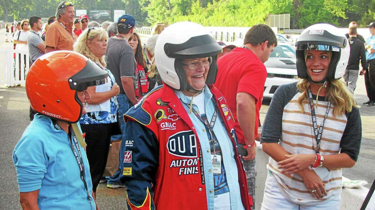 Peggy Mayer, 82, center, of Vernon, rode along for some hot laps with NASCAR's Jeff Gordon at Lime Rock Park Thursday, accompanied by her daughter Sue Thomas and granddaughter Lindsay Thomas.