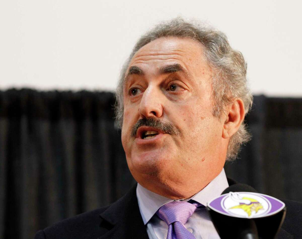 """Minnesota Vikings owner Zygi Wilf speaks during a news conference Wednesday in Eden Prairie, Minn. Hours after reversing course and benching Adrian Peterson indefinitely, Wilf said the team """"made a mistake"""" in bringing back their superstar running back following his indictment on a felony child-abuse charge in Texas."""