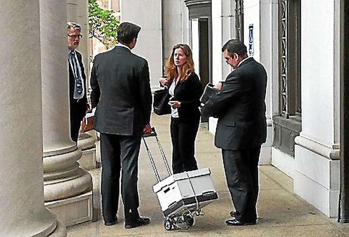 Assistant Attorney General Maura Murphy Osborne, center, SEEC Executive Director Michael Brandi at right.