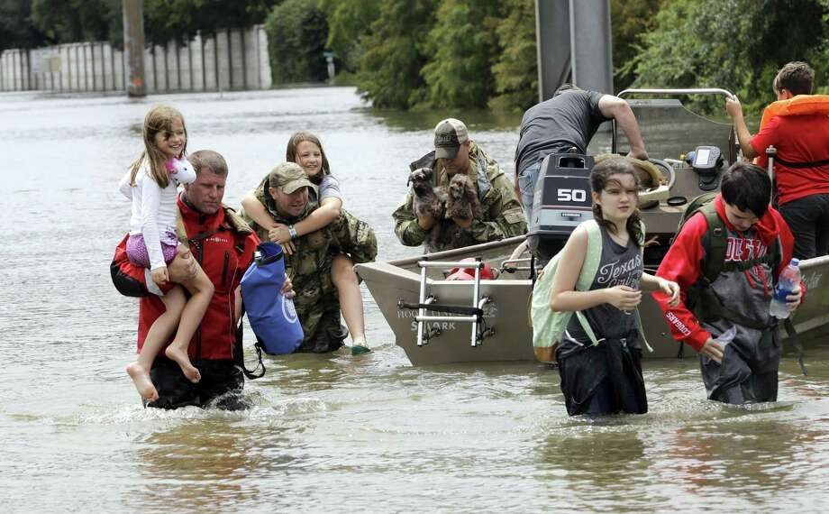 Click through the slideshow for a look at local groups and organizations helping victims of Hurricane Harvey.  Photo: David J. Phillip / Associated Press / Copyright 2017 The Associated Press. All rights reserved.