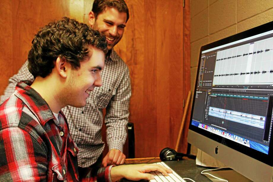 Torrington High School sophomore Evan Dunlap (seated) laughs as he gets some editing advice from Benjamin Willis of the Civic Life Project on Wednesday, May 21, 2014, in Torrington. Register Citizen Esteban L. Hernandez Photo: Journal Register Co.
