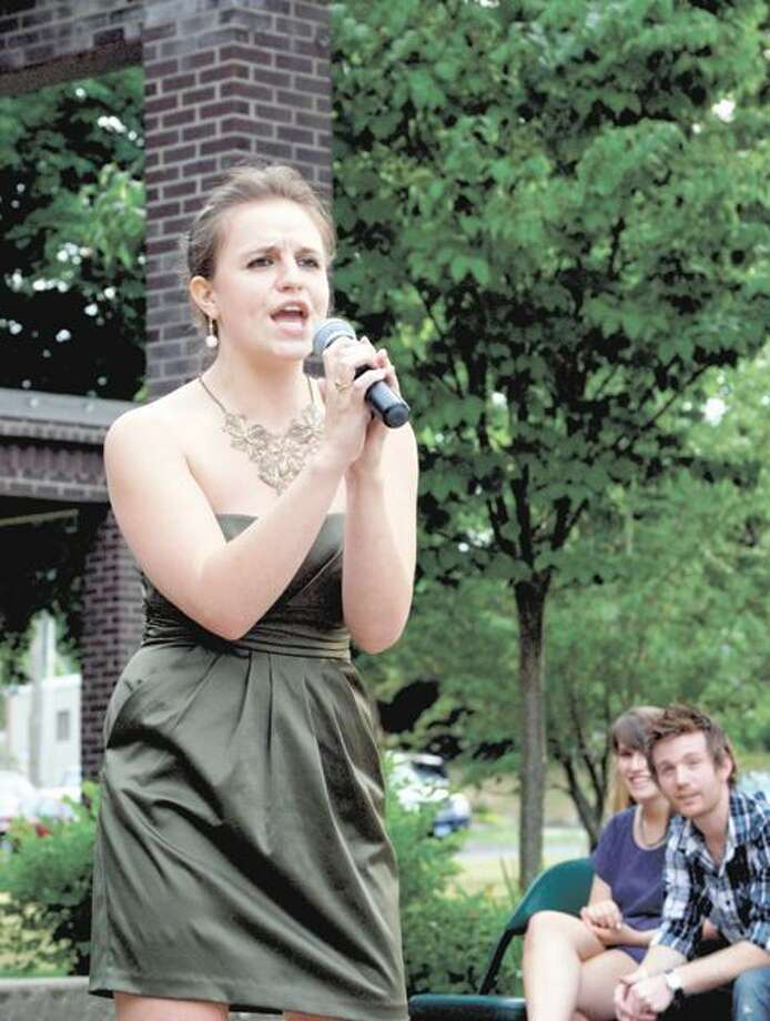 "RONALD DeROSA/Register CitizenNorthwest Idol finalist Theresa Murphy, 18, performs ""Hey Big Spender,"" by Peggy Lee, during the competition's semi finals on Saturday at Coe Memorial Park. Murphy, of Goshen, was one of six chosen to progress forward to the Aug. 8 final competition at the Warner Theatre."